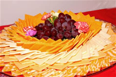 How To Decorate Cheese Platter by Flowers From Salami Sausages And Cheeses Stock Photo