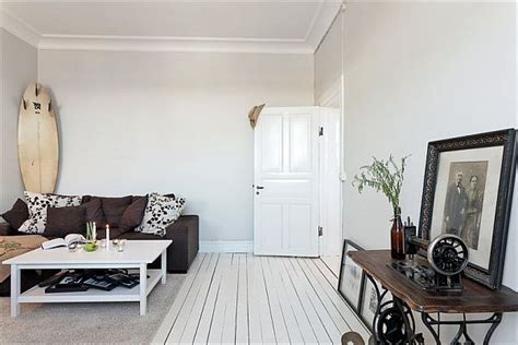 Living Room White Walls by Tiny Apartment Renovation Featuring White Walls