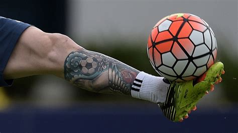 messi tattoo since ta two messi covers up old leg ink goal com