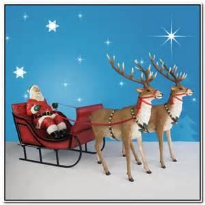 Outdoor santa and reindeer decorations