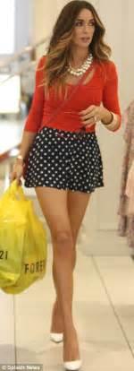 Polkadote Style Blue Orange Mini Dress bingham swaps dungarees for polka dot skirt that shows slender legs on shopping