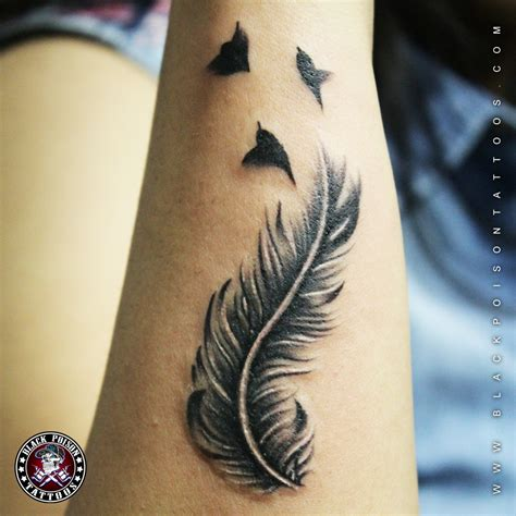 feather with birds tattoo meaning feather tattoos and its designs ideas images and meanings