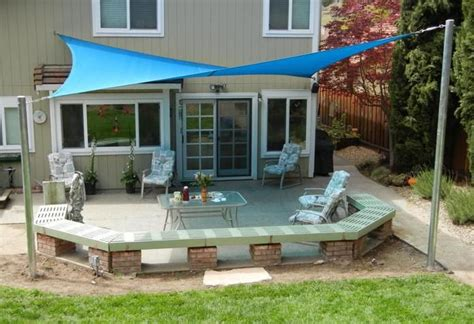 Instant Patio by U Shaped Bench Made Out Of Brick Sun Shade Sails Create