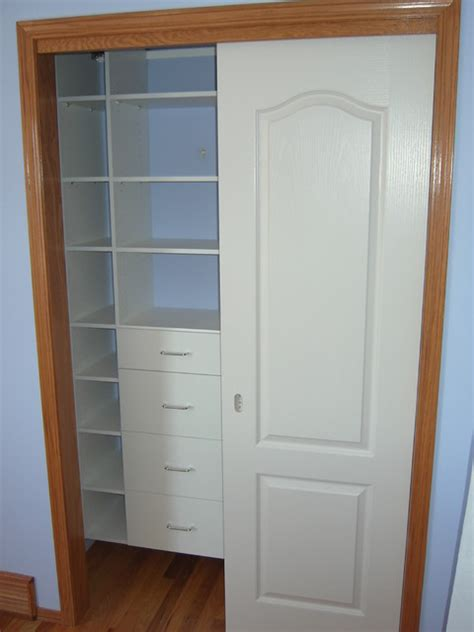 Reach In Closet Doors Reach In Closet With Sliding Doors Traditional Closet Calgary By Kwik Kloset Calgary West