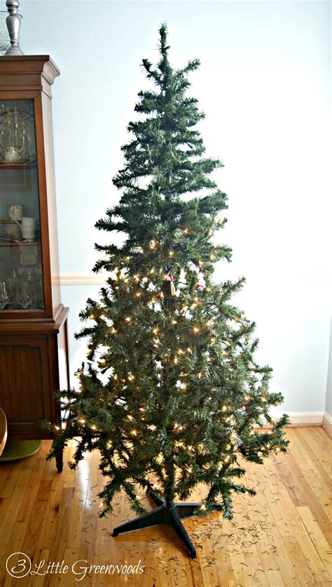 trick for making a fake christmas tree look fabulous must pin trick for making a fake tree look fuller don t