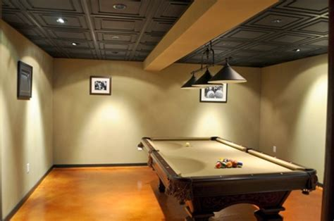 Using pressed tin ceiling tiles is a great idea to update any basement