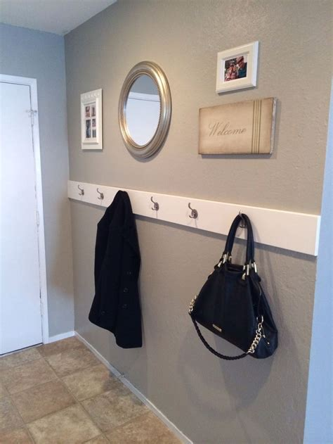 our new entry way 5 5 quot x1 quot mdf board and 6 hooks wall paint is valspar woodlawn colonial gray