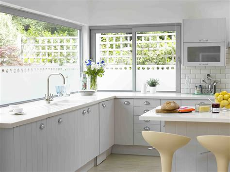 Kitchen Window Design Ideas by Lovely White Kitchen Design With Grey Polished Framed