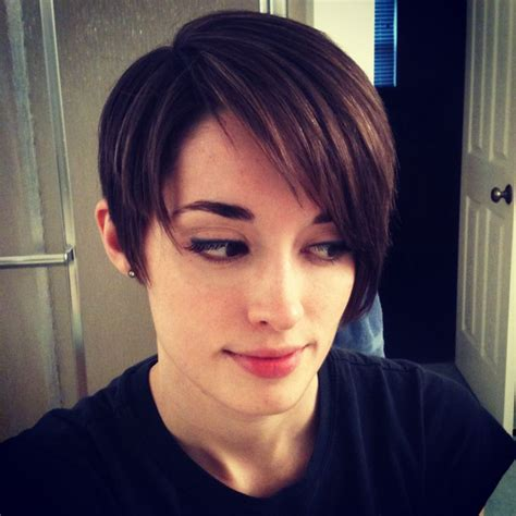 pixie cut covering ears with bangs a long pixie cut asymmetrical side swept bangs cut out