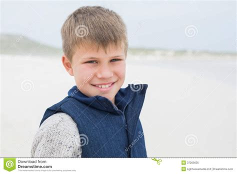 close up portrait of cute young boy stock image image closeup of a cute smiling boy at beach stock image image