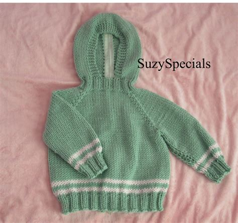 knitting pattern baby sweater zipper up back hooded knitted baby sweater in with back zipper in pale green