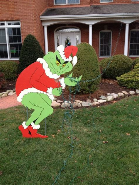 grinch stealing christmas lights yard art decoration