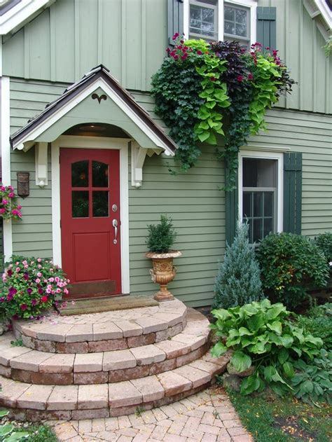 Front Door Colors For Green House This Small Home S Color Scheme Is Charming The Soft Understated Light Green Siding White Trim