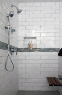 modern white shower with subway tile and bench