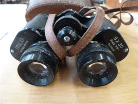 a pair of milo coated optics 8x30 lot 243 busby