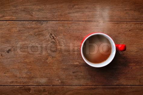 desk mate coffee cup warmer cup coffee on wood background stock photo colourbox