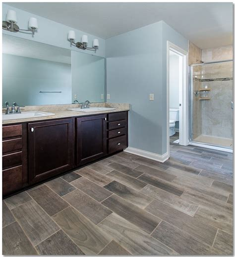 master bathroom with custom tiled shower and wood look