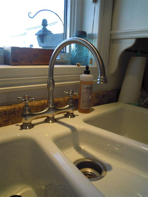 can you use an undermount sink with a laminate countertop can i do a bridge faucet with a drop in sink pic