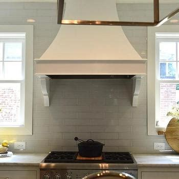 range hood sarl in the french kitchen flanked by windows design ideas
