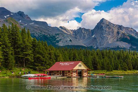 canoes lake maligne boat house and canoes at maligne lake in jasper national park