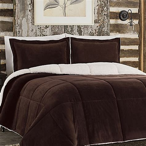 so soft plush reversible comforter set in chocolate bed