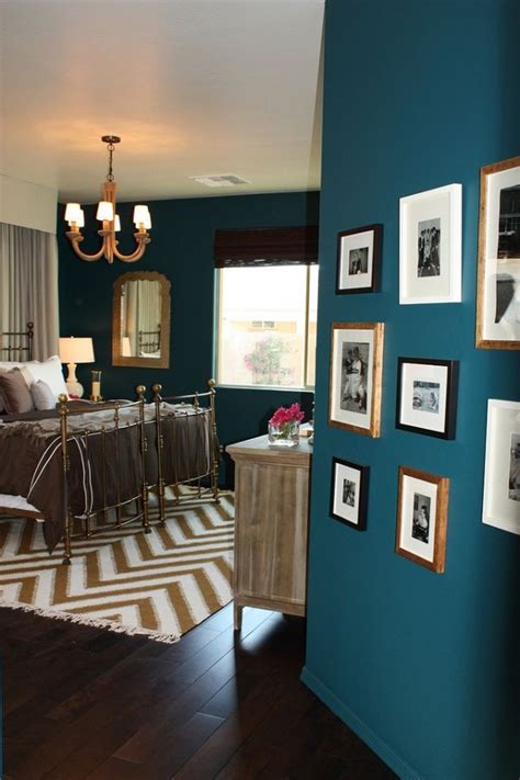 teal walls for the living room also loving the wood floors for the home