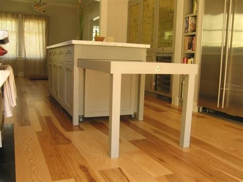 kitchen island with pull out table such a functional kitchen island hidden casters allow