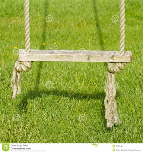 old wooden swing old wooden tree swing stock images image 27341024