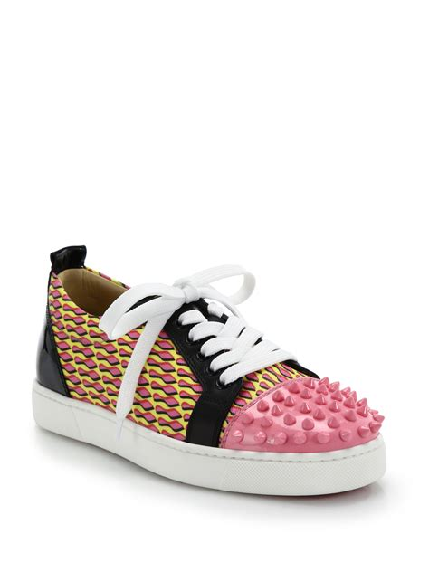 christian louboutins sneakers lyst christian louboutin louis jr studded leather