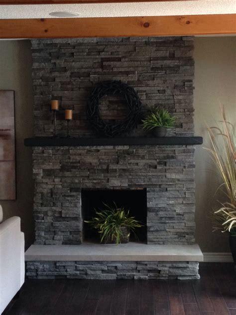 stacked stone  brick fireplace remodel quartz hearth
