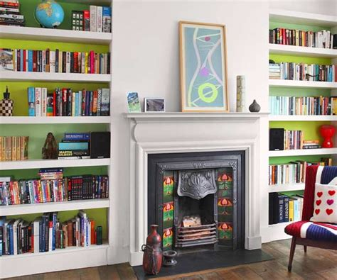 vibrant bands inside bookcases with a color pop this house