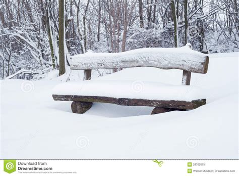 bench in snow snow covered park bench royalty free stock photo image