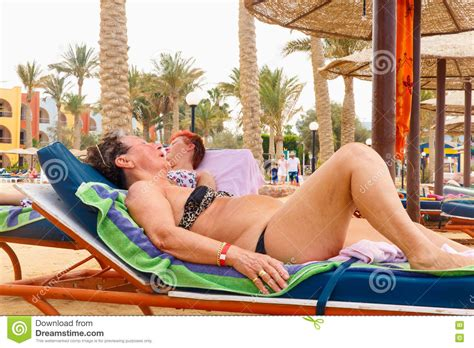 Dreams Palm Beach Resort by Old Women Resting On The Beach Editorial Photo Image