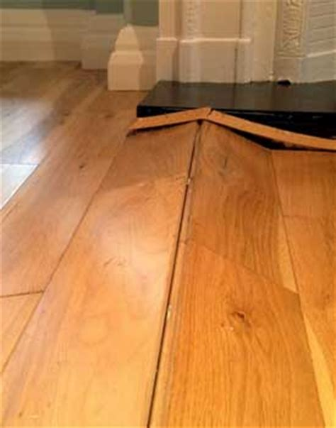 Hardwood Flooring In Kitchen Problems by Hardwood Floor Buckling Buckled Wood Floor Solutions