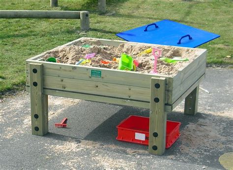 with sand on table covered sand table with lid pentagon play