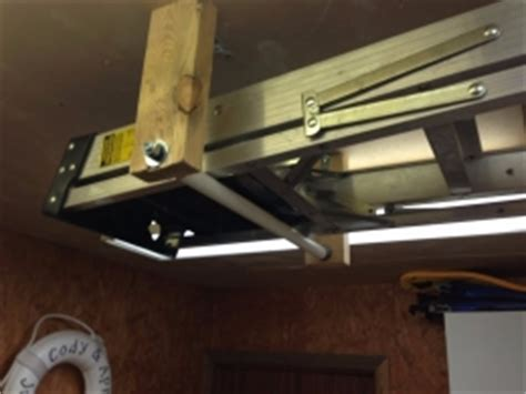 homemade ceiling mounted ladder storage