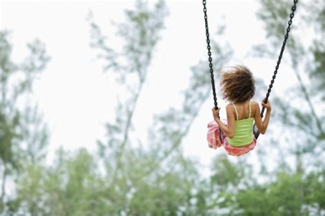 child on swing childhood development the link between neglect and brain