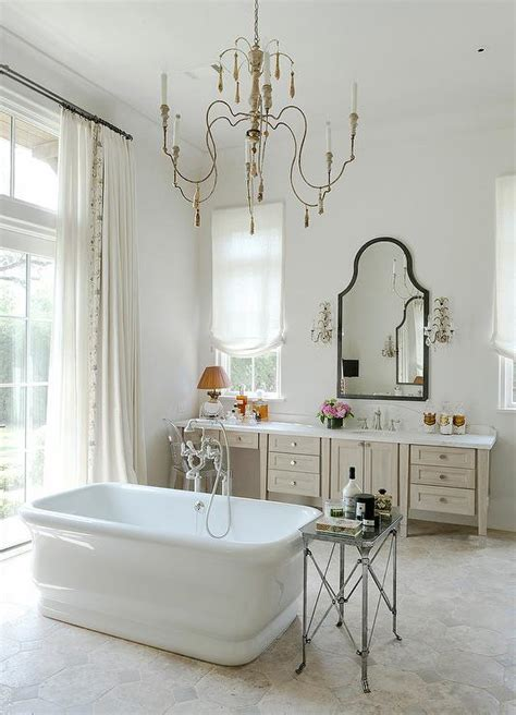 french bathrooms french bathroom with mirror and brass wall sconces