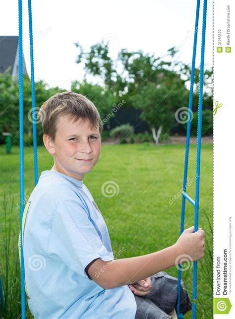 sitting swing teenager sitting on a swing stock photography image