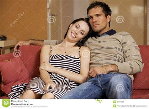 young couple room young couple watching tv in hotel room stock photo image