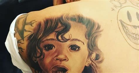 tattoo pain period chris brown tattoos daughter s face on his back