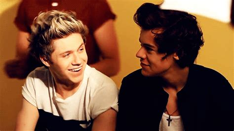 niall horan and harry make the most of the sun on their one direction narry storan gif find share on giphy
