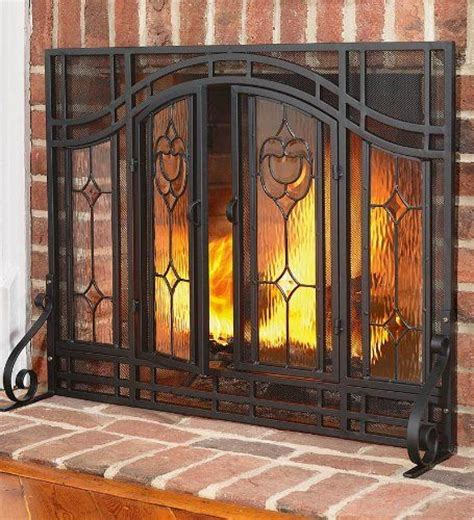 large two door floral fireplace screen with beveled glass