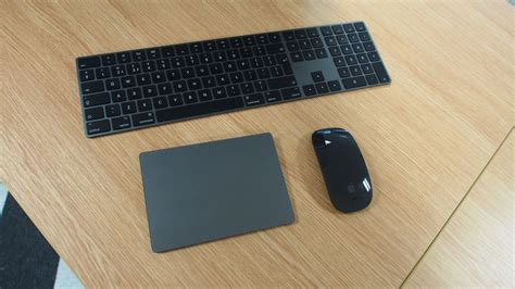 apples space gray magic mouse keyboard  trackpad