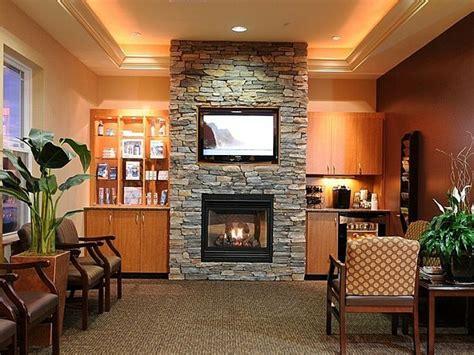 tv above stacked brick fireplace fireplace