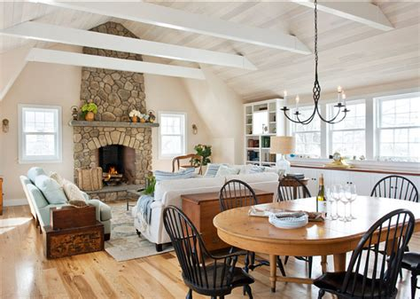 living room beach cottage with wood flooring and sloped ceiling east coast style beach cottage home bunch interior