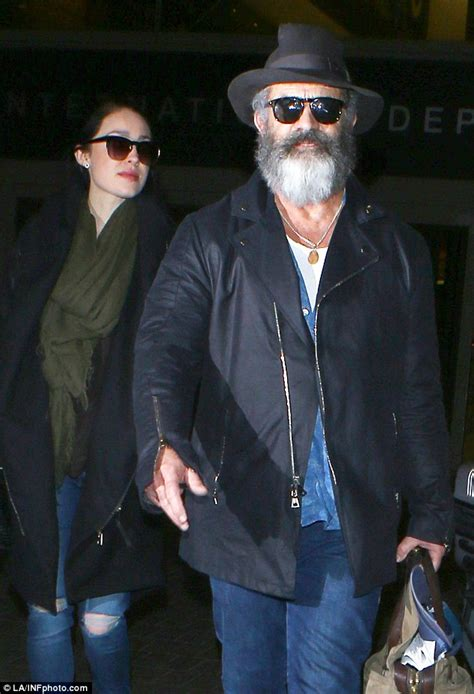 mel gibson locks lips with 24 year old girlfriend rosalind ross in mel gibson jets into lax with pregnant girlfriend rosalind