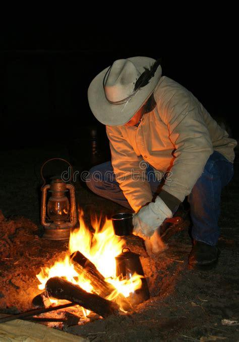 cowboy   fire  dawn stock image image