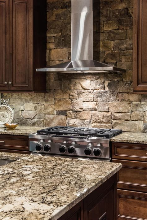 layered backsplash a stainless steel range is a sleek contemporary