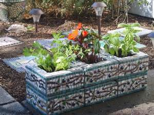 custom designed mosaic cinder block herb garden planter